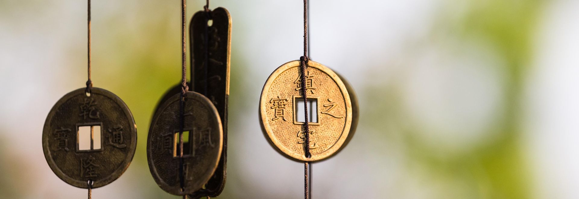 Antique Chinese coins hanged outside the house as wind chimes  for protection and good luck