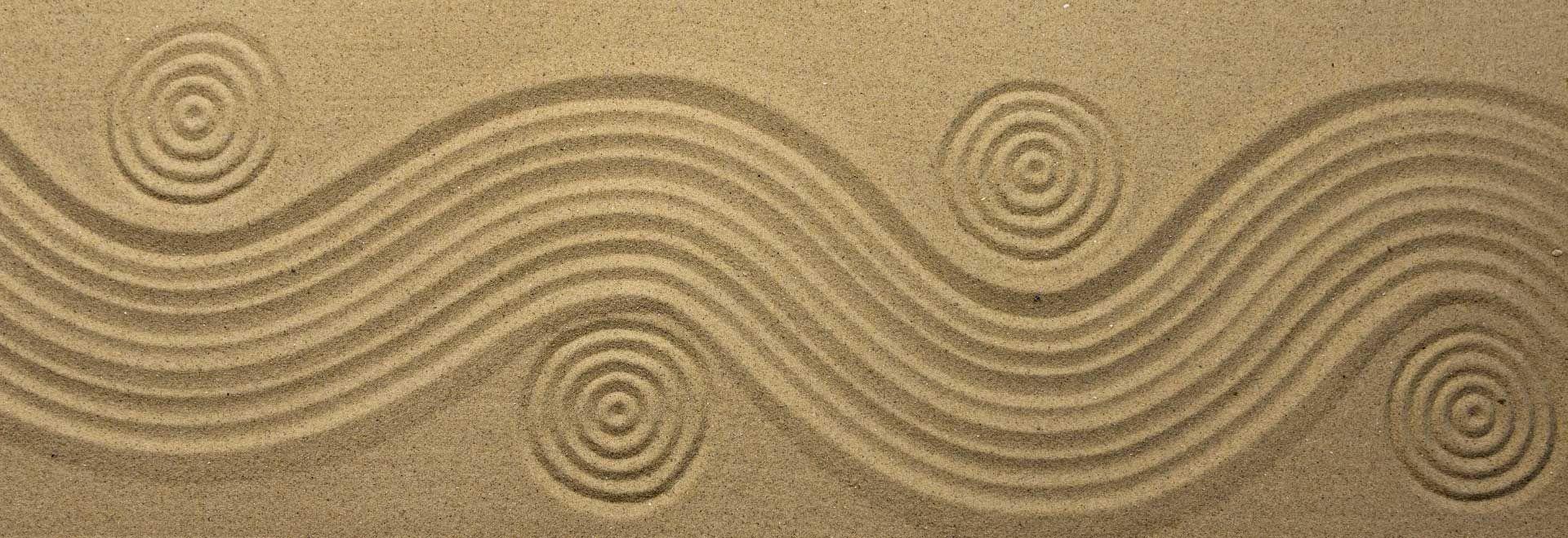 Wellenmuster im Sand